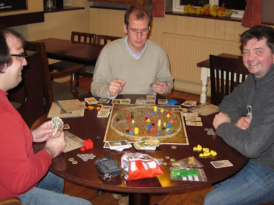 Discworld:Ankh-Morpork - The players with The Dragon King looking fairly happy about life in the troubled city