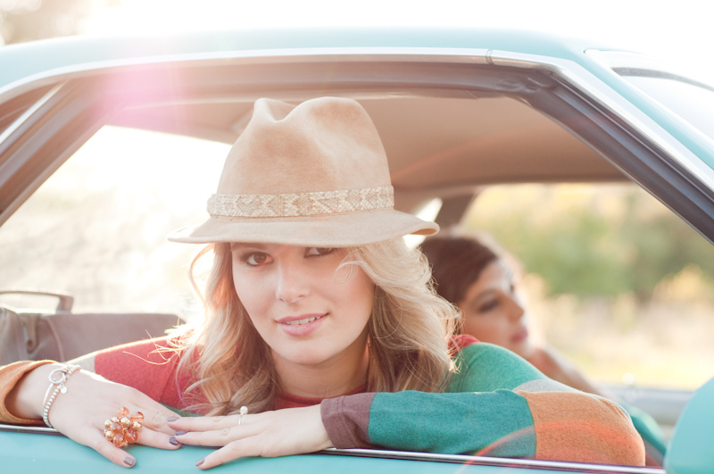 Vintage chic blonde girl in a classic car