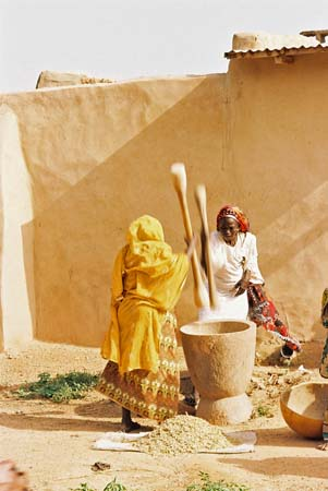 Pounding grain is a communal activity in Africa