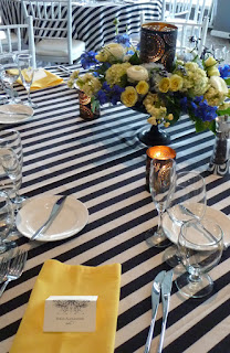 Black and white strips and spring centerpiece - Photo by Patricia Stimac, Seattle Wedding Officiant