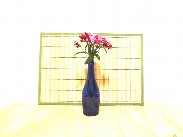 flowers in blue bottle, high exposure