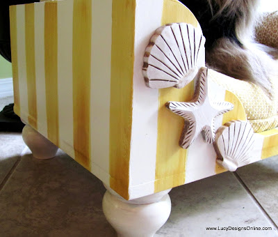 yellow striped dog bed beach theme