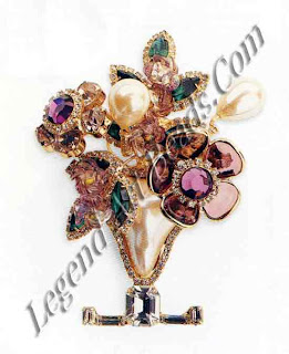 This brooch by Limy Vrba is hand-assembled and the stones handset. It is this attention to detail, and sometimes outrageous designs, which make Vrba jewelry very desirable. It also possesses Vrba's signature three-dimensional quality. He uses interesting materials and unusually shaped and coloured stones.