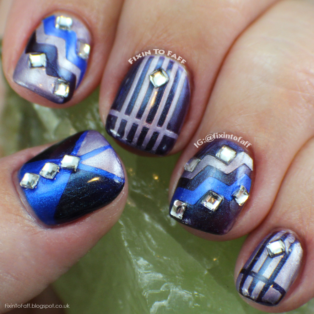 Blue and purple tape mani with rhinestone accents.