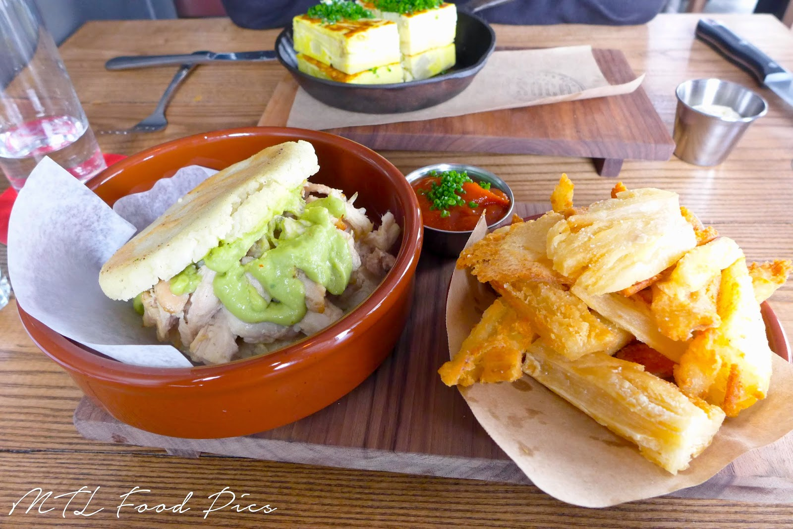 chicken avocado arepas with yuca fries - venezuelan cuisine
