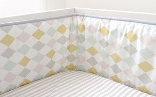 Olli Ella | Contemporary Nursery Bedding | Harlequin Dawn Cot Bumper. Shown in close up.