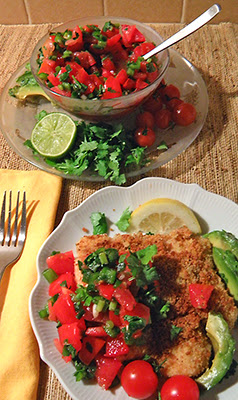 Individual Plate of fish with Large amount of salsa, avocado, cilantro and tomatoes