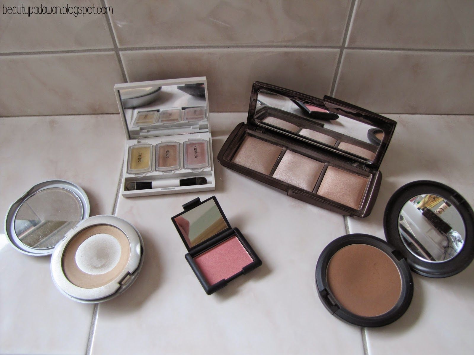 "Benefit Perk Up Artist; Stila Illuminating Powder - ""30 Watts""; Hourglass Ambient Lighting Palette; NARS Blush - ""Deep Throat""; MAC Bronzing Powder - ""Matte Bronze"""