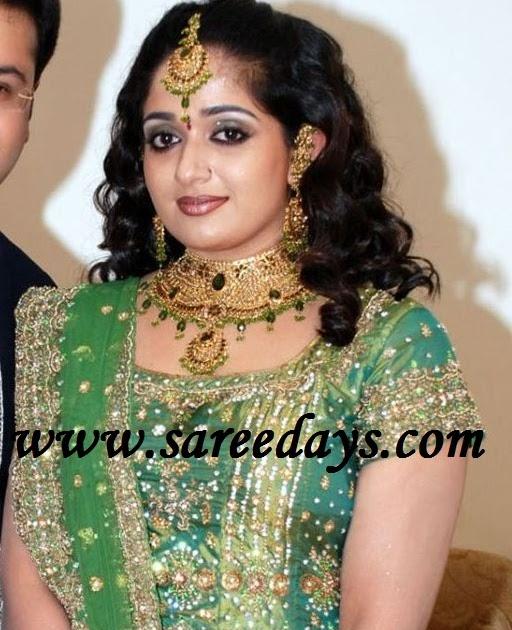Latest saree designs kavya madhavan in green bridal lehenga with latest saree designs kavya madhavan in green bridal lehenga with heavy work altavistaventures Images