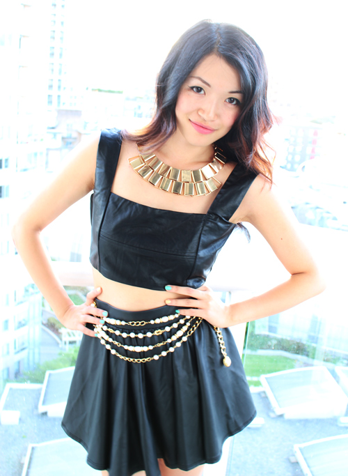 Vancouver Fashion blogger Jasmine Zhu wearing leather croptop and leather skater skirt with gold accent jewelery, fall transition outfit