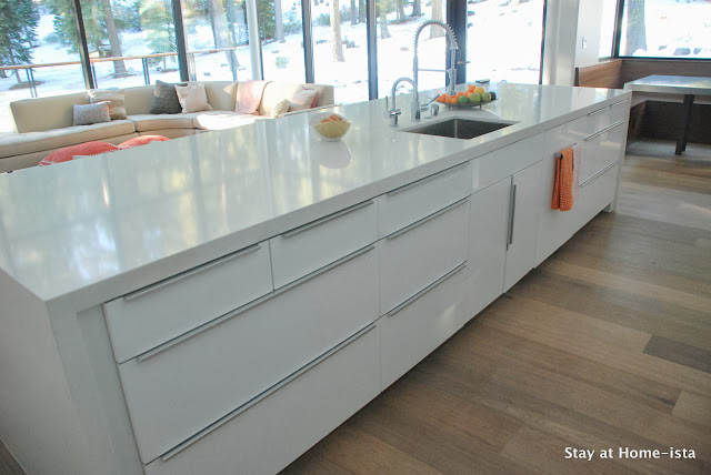 Ikea kitchen customized with a waterfall quartz countertop
