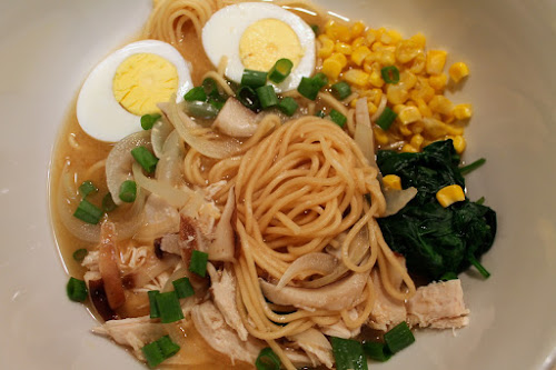 Chicken miso ramen with spinach, shiitake mushrooms, corn and eggs