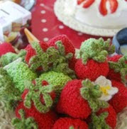 http://www.letsknit.co.uk/free-knitting-patterns/strawberries