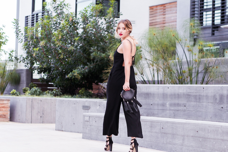 Date night outfit idea – how to wear a jumpsuit on a date rebecca minkoff fringe tassel small circular bag