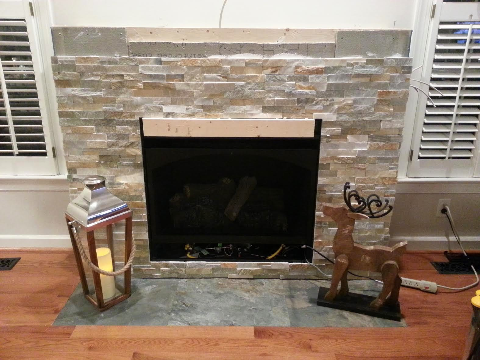 quartz_stacked_stone_fireplace_slate_floor