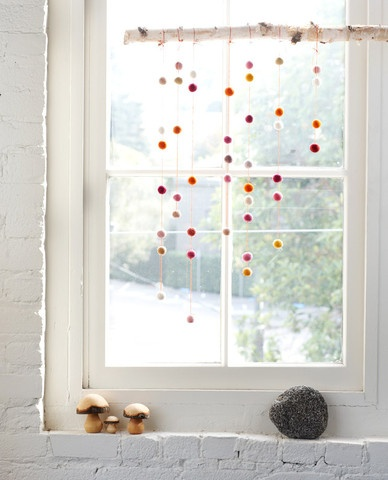 window decoration for winter and holidays - colorful felt balls