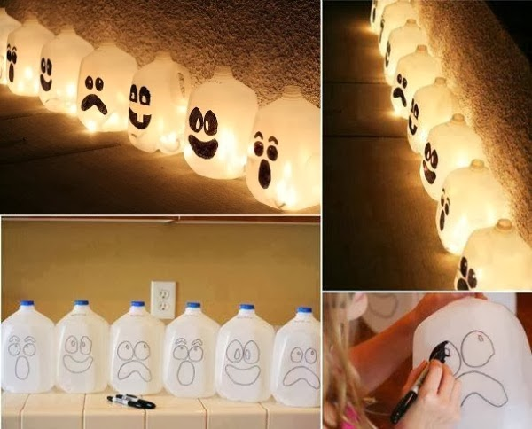 this is an form of halloween decorations collect the plastic cans draw the halloween masks on them by using markers then hang the bulbs inside them