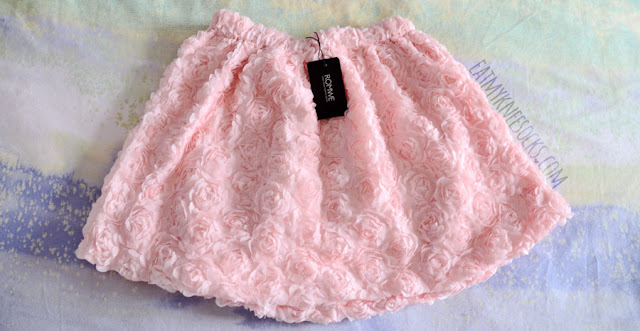 Romwe's pastel pink 3D rose skirt has an allover rose embellishment, along with an elastic waistband and flared fit.