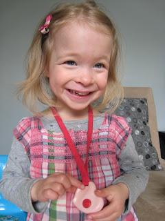 Artemis Wearing Pink Heart Chewelry