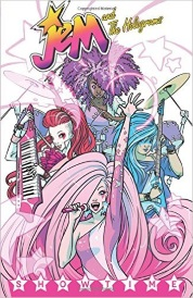 Cover of Jem and the Holograms Volume One, featuring a number of young women of various races singing and playing instruments.