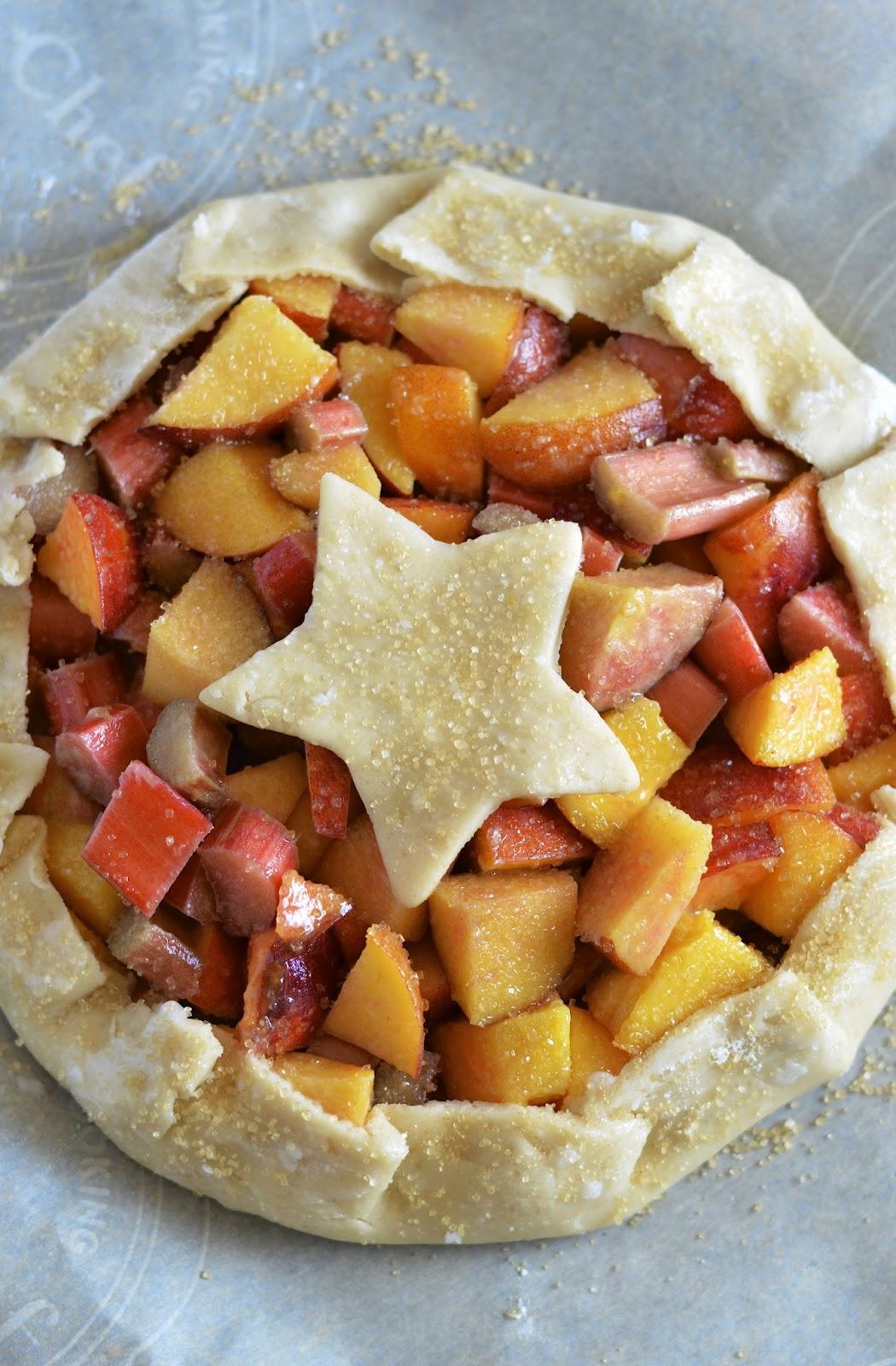 A brightly flavored vegan peach rhubarb crostata with vegan coconut whipped cream