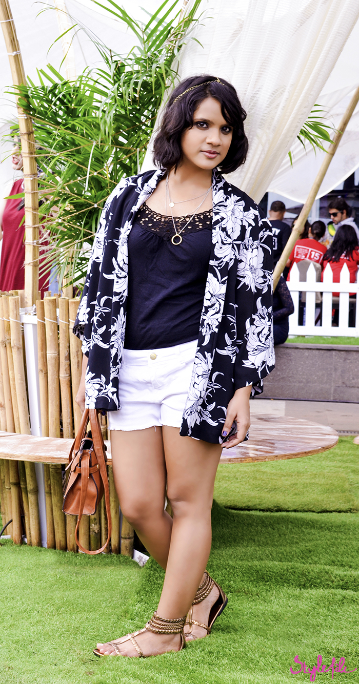 Dayle Pereira of Style File showcases a personal style blog post of an outfit with bohemian influences as she wears a Westside printed kimono with Zara frayed shorts, metallic Payless gladiators, a head chain and Forever 21 layered necklace with a Promod micro messenger bag