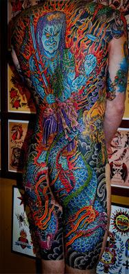 Full body tattoo of a blue dragon man in flames by tattoo artist Jason Kunz for Triumph Tattoo