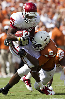 Ryan Broyles #85 of the Oklahoma Sooners is tackled after catching a pass by Christian Scott #6 of the Texas Longhorns at the Cotton Bowl on October 8, 2011 in Dallas, Texas. The Sooners defeated the Longhorns 44 to 3. (October 7, 2011 - Source: Wesley Hitt/Getty Images North America)