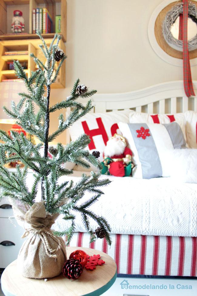 small christmas tree on tripod table