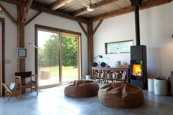 Modern rustic living room with wood burning stove and bean bag chairs