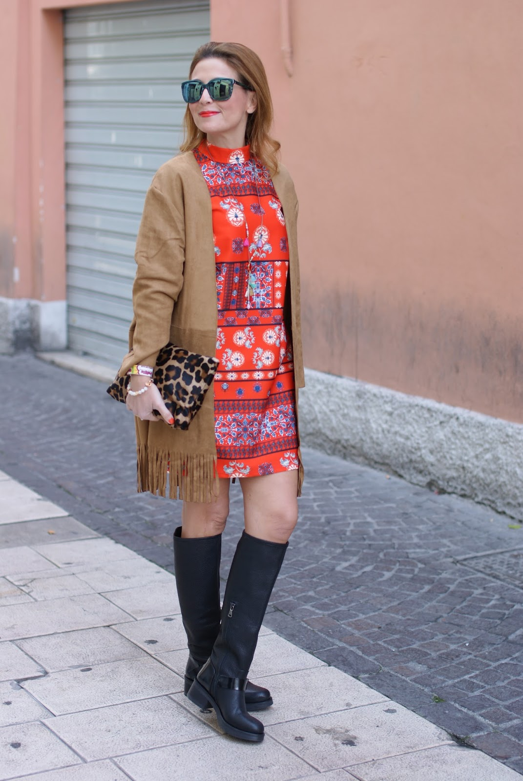 Suedette fringed coat from Yoins, orange folk dress and Lorenzo Mari boots on Fashion and Cookies fashion blog, fashion blogger style