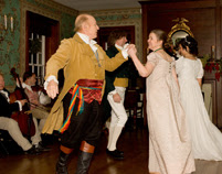 dancers in the ballroom at locust grove during the candlelight tour demonstration dances from the early 1800s and dressed in period costumes one man in a kilt and one in  a soldiers outfit and ladies in long white gowns