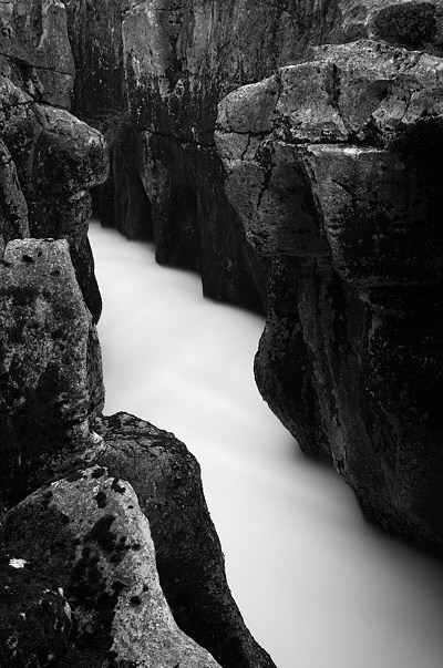 Black and white image of Valserine river running in a narrow canyon
