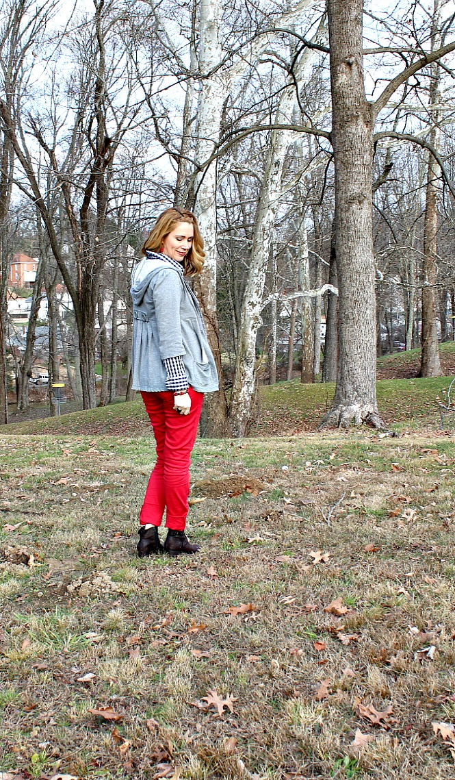 red skinny jeans, plaid shirt, graphic T shirt, brown boots