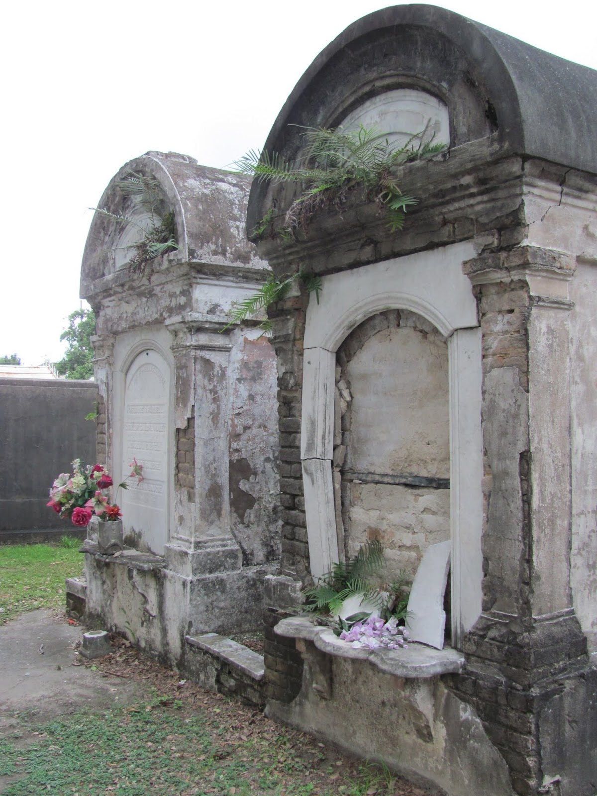 Two vaults crumbling in LaFeyette Cemetery in New Orleans, LA