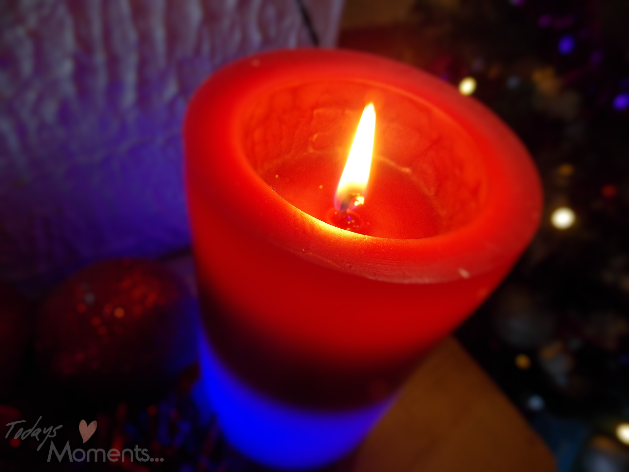 red and blue colour changing flame burning candle