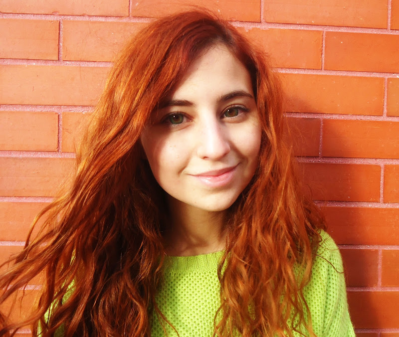 red haired girl with green contact lenses