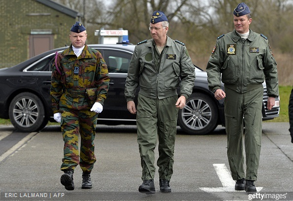 King Philippe of Belgium, escorted by Base Commander Georges Franchomme, arrives for a visit to the Beauvechain Air Base.
