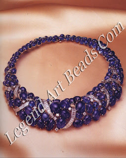 A collar necklace made up of 357 carats of cabochon sapphires and ribbons of baguette diamonds.