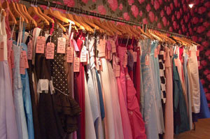Odd, out of date, and out of style dresses line a rack in a second-hand shop; which, in NTCC jargon, is called a 'KOOK STORE'; because only kooks would shop there.  But NTCC financially drains its members, reducing them to shop at these places while NTCC board members flaunt their wealth and wardrobes from the best stores.