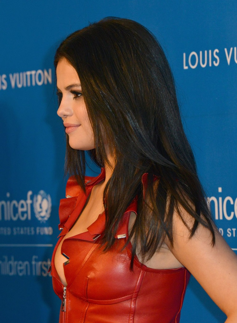 Selena Gomez bares cleavage in leather dress at the UNICEF Ball in LA