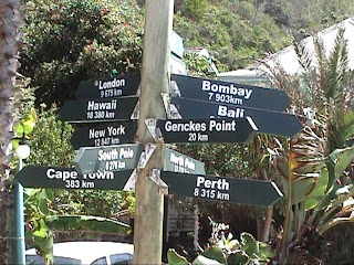 World distances sign Victoria Bay South Africa