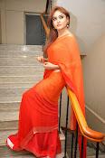 Sony Charista Glamorous in Saffron saree-thumbnail-6