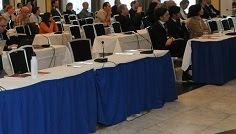 Empty chairs at Bonn Climate Conference during IEA report briefing.