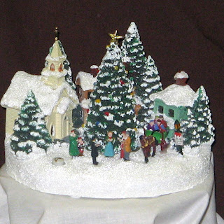 Order the Teleflora Thomas Kinkade Christmas Carolers Village