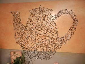 DESIGN ON WALL OF ANTHROPOLOGIE STORE IN U DISTRICT OF SEATTLE