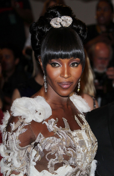 Naomi Campbell in a white heavily fringed Alexander McQueen gown at the 2011 MET Gala.