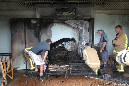 Fire Service and Black Barn staff try to work out what caused the fire after a fold-up bed caught fire in a pool room at Black Barn Retreats, Tukituki Rd, also used for accommodation, not part of the main house. The fire was put out by cleaners and caretakers. photograph