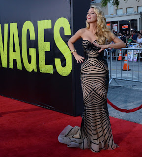 Blake Lively posing on the red carpet ina floor length gown by Zuhair Murad