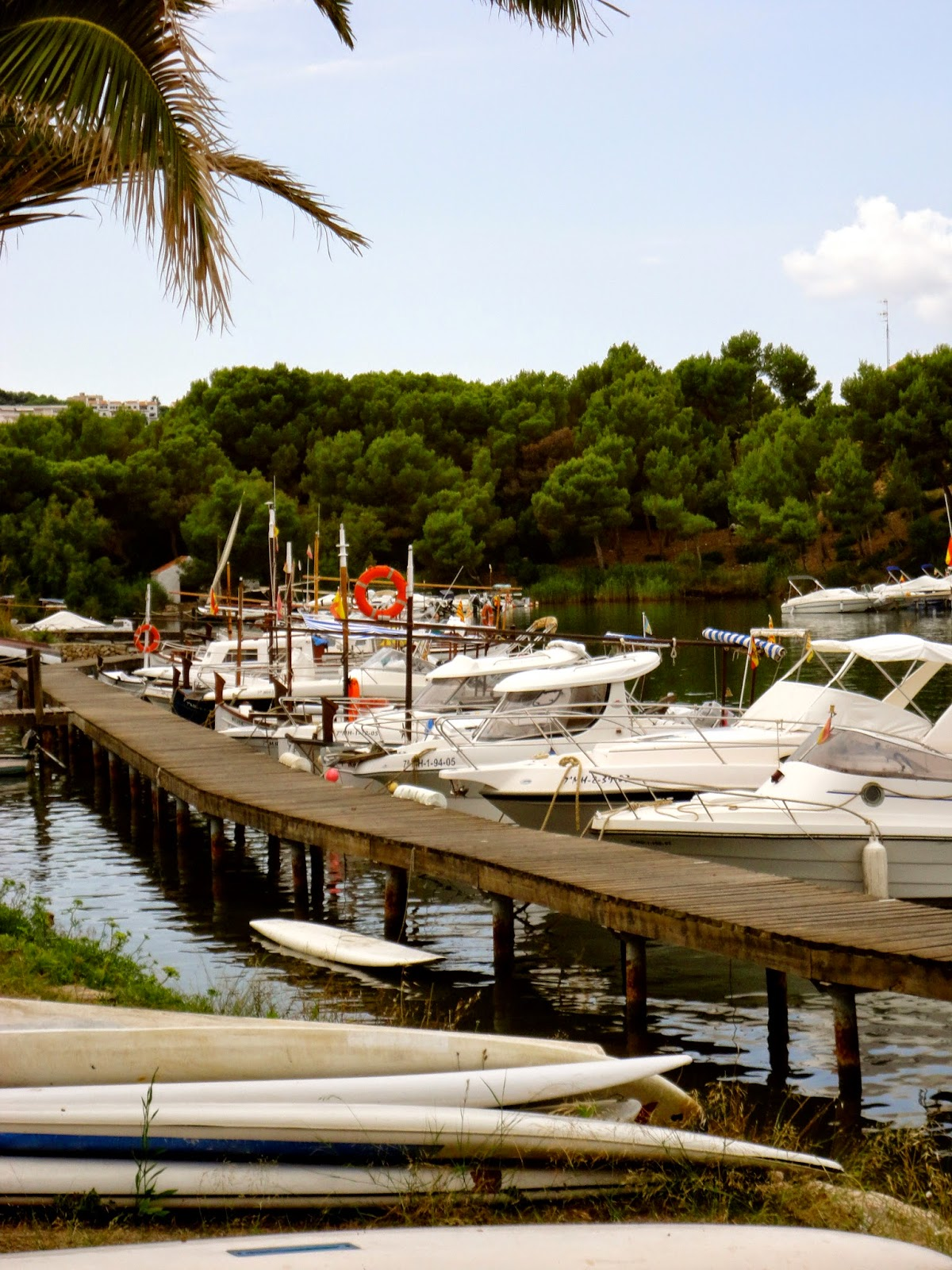 Travel Inspiration | Menorca, Spain | wooden jetty and boats in port